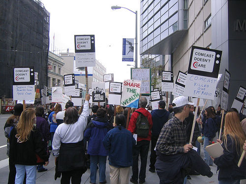 """Comcast protest"" by Flikr user Steve Rhodes used under Creative Commons Attribution 2.0 license"